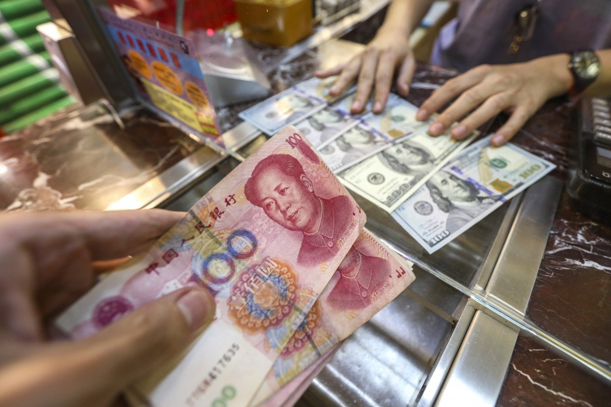 China's cut of US dollar weighting in key index will boost global fortunes of yuan, economists say