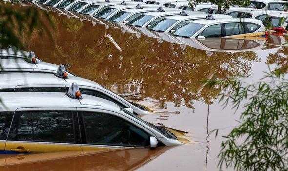 Indonesia floods: Nine killed as freak rainfall sparks New Year's Eve chaos