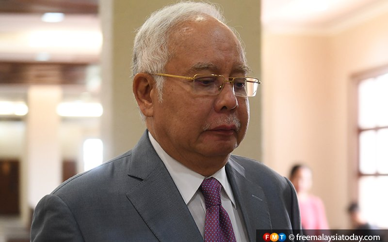 Najib says he doesn't know who forged signature