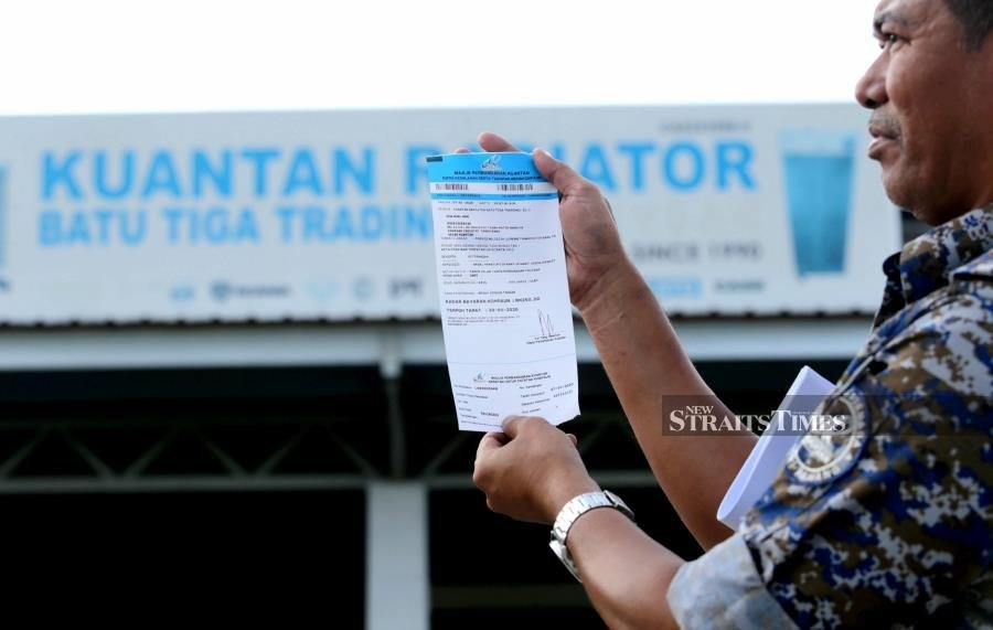 Jawi signage in Pahang: Stickers allowed, for now