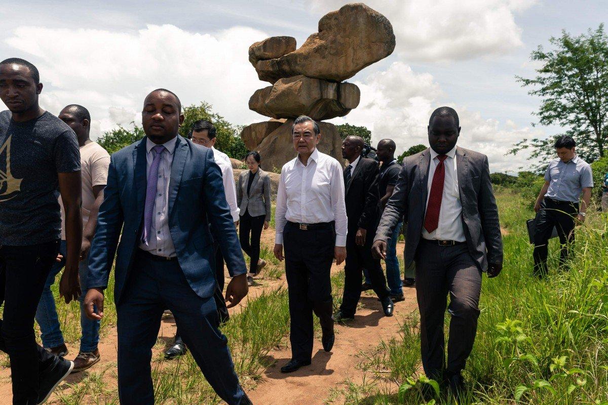 China's Foreign Minister Wang Yi backs call to lift sanctions on Zimbabwe