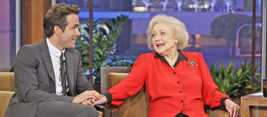 Ryan Reynolds Is Attempting To Outdo Sandra Bullock While Serenading Betty White, Of Course