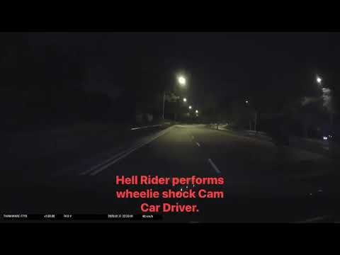 Hell Rider with no headlights & rear lights performs wheelie