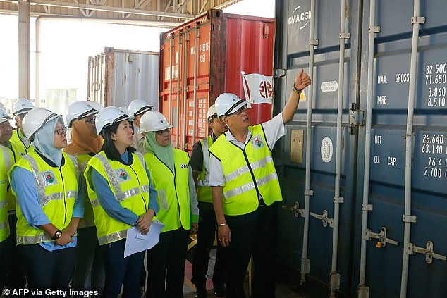 Shipping containers filled with plastic waste are sent back to countries including Britain and the US after Malaysia declares 'we are not the world's garbage dump'