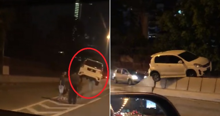 """Video: """"Flying"""" Myvi Gets Stuck On Top Of Divider at JB, Netizens Amazed"""