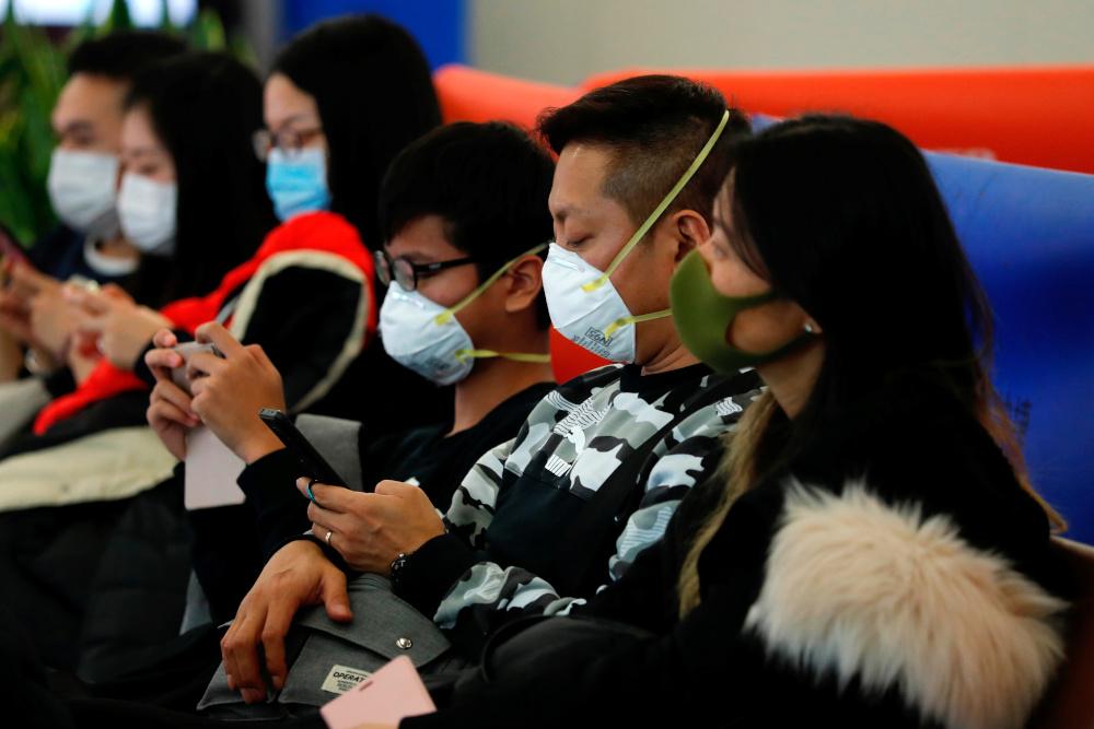 Authorities scramble to contain rumours of Wuhan coronavirus spread