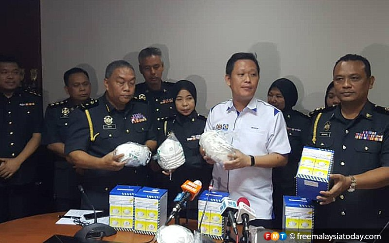 3 Sabah shopowners hauled up for hiking prices of face masks