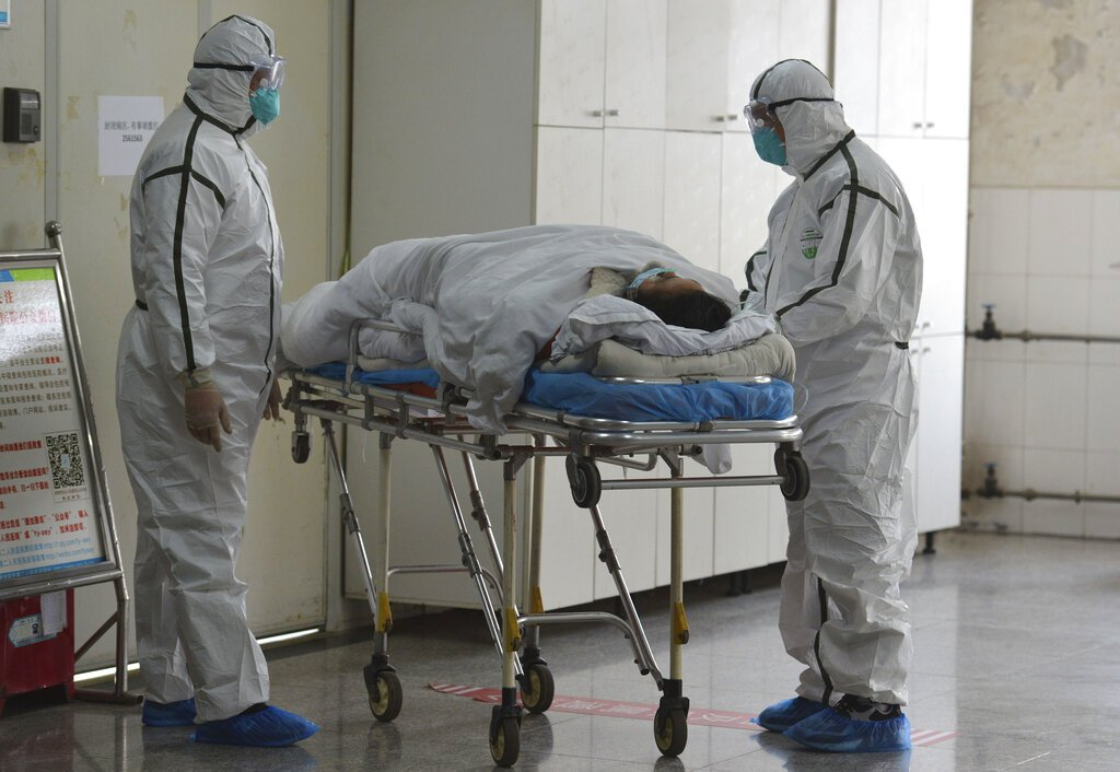 30 more die from virus in China as new infections, imported cases rise