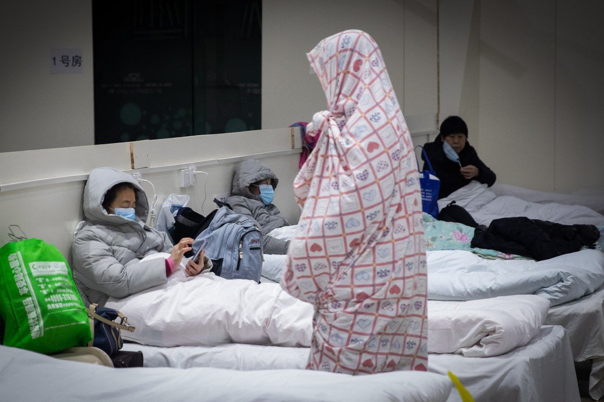 Desperate patients struggle to get help in coronavirus-hit Wuhan as others wait it out