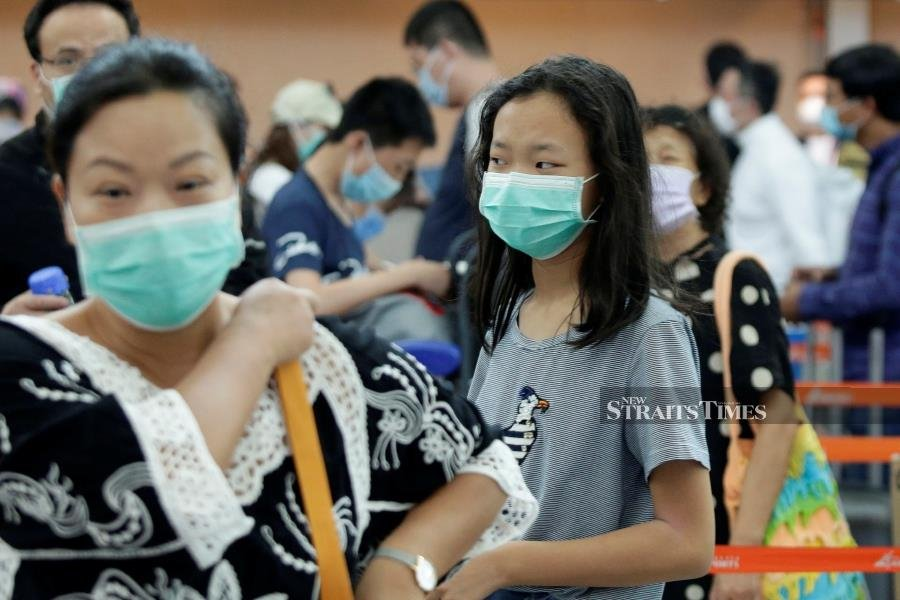 Malaysian woman tests positive for coronavirus; infections tally at 17