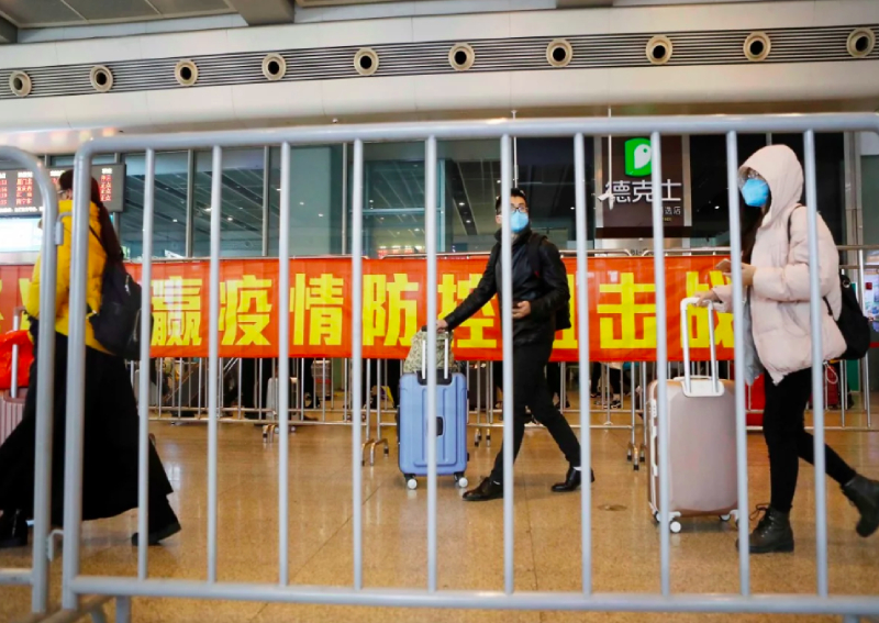 Chinese cities keen to get back to work but coronavirus concerns grow as workers return