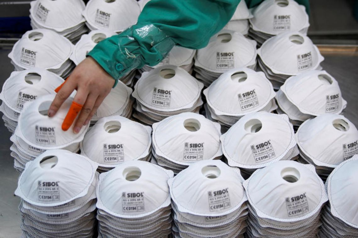 Coronavirus: Chinese factories suspend own production to make masks in fight against virus