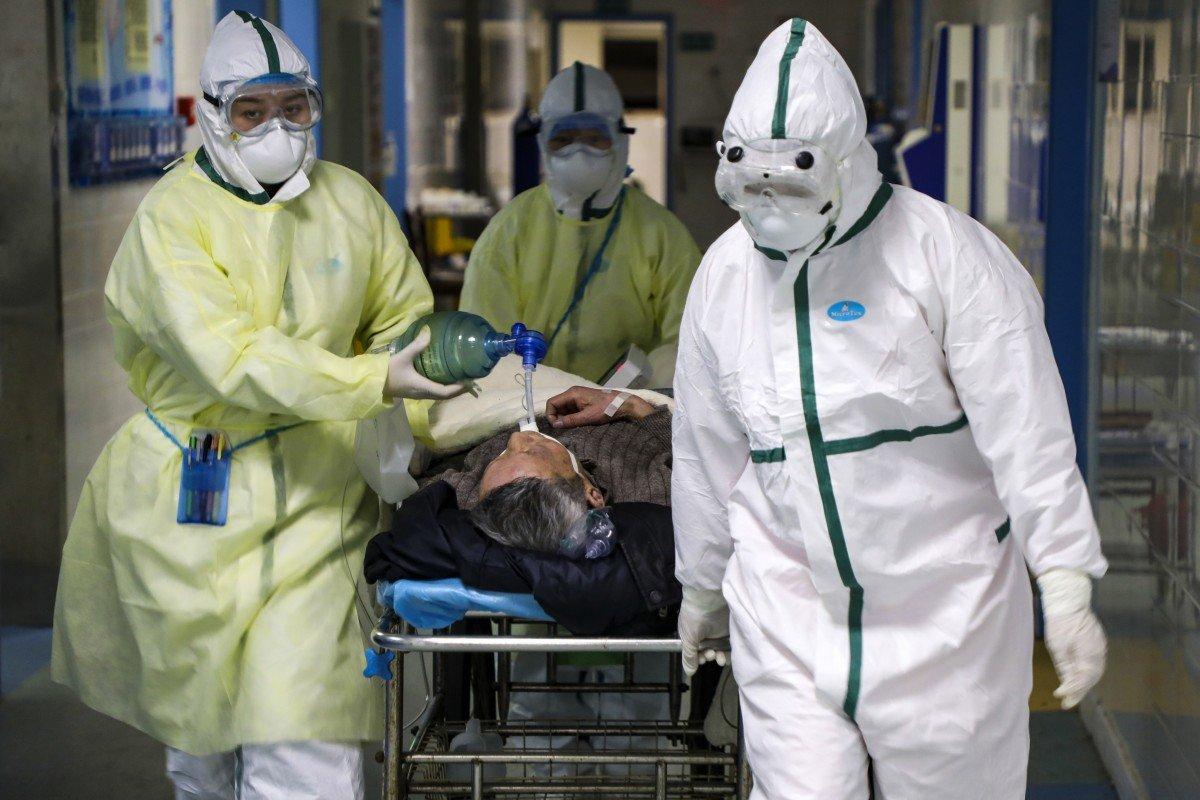 Coronavirus: Wuhan doctors battle outbreak in diapers as masks rub their faces raw