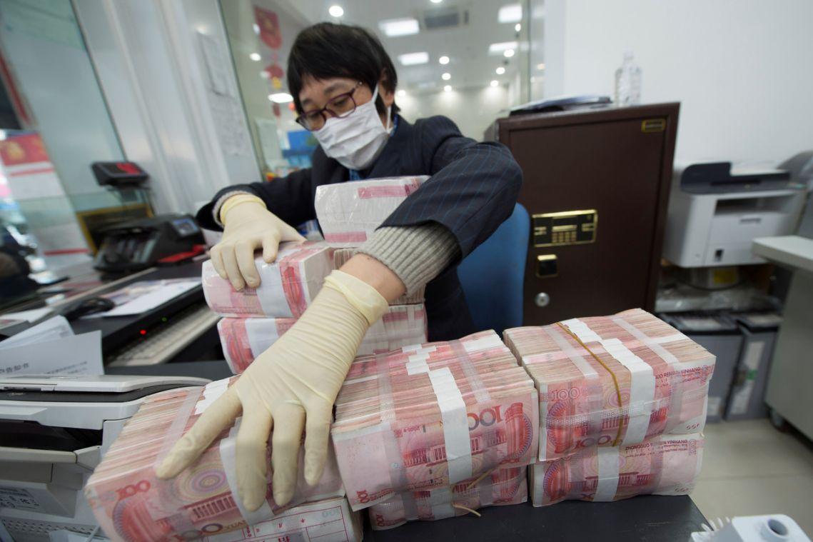 China cleans, locks away banknotes to stop coronavirus spread