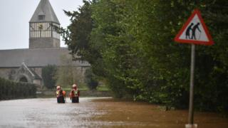 Storm Dennis: Care home staff carried through floods by tractor