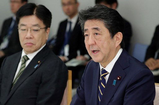 Japan's Abe urges 2-week curbs on sports events as coronavirus looms over Olympics
