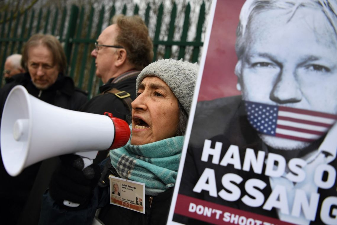 Julian Assange in British court outburst over distance from lawyers