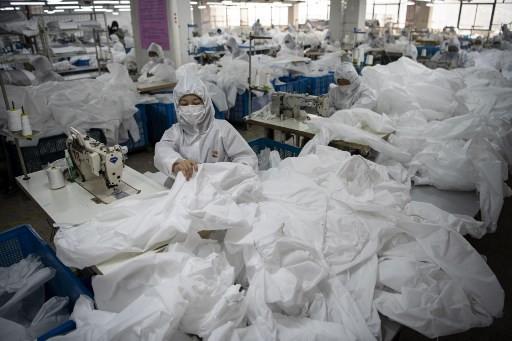 In virus-hit China, coat maker adapts to make hazmat suits