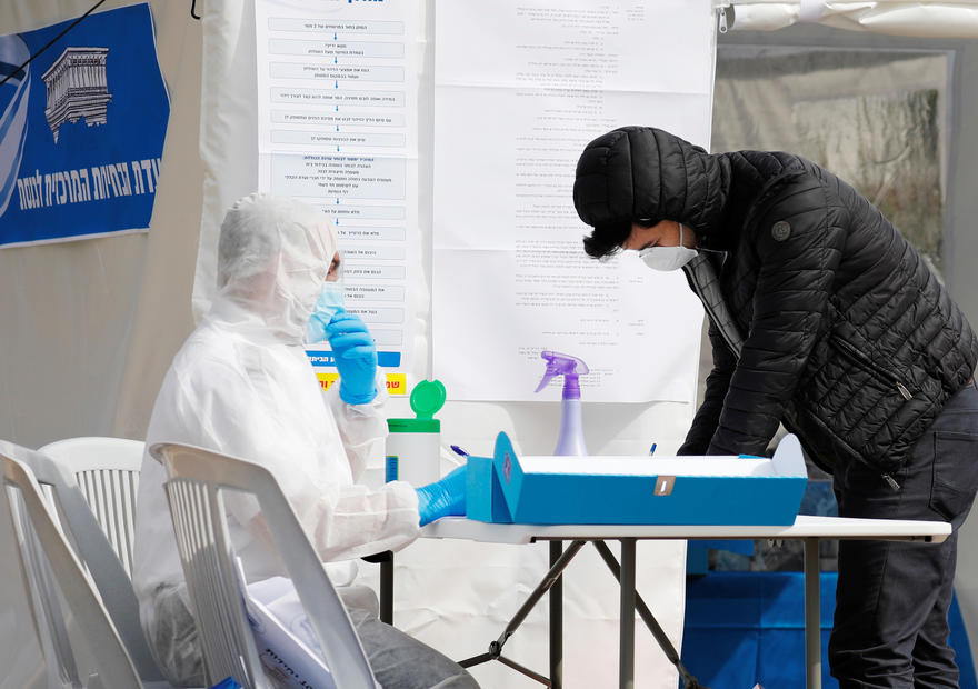 Masked and gloved: Israelis in quarantine from coronavirus vote in election