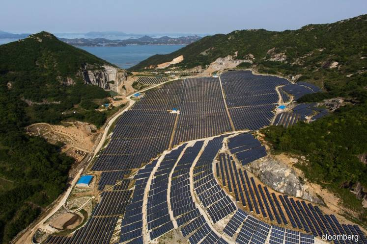 Asian finance group pushes softer standards for green deals