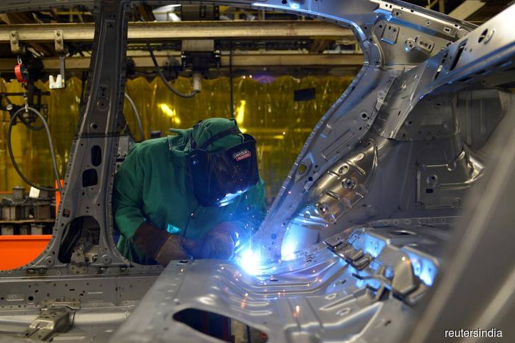 U.S. manufacturing sector slows; construction spending hits record high