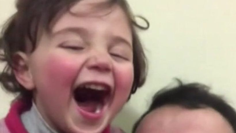 Syria war: Three-year-old girl who laughed at bombs escapes to Turkey