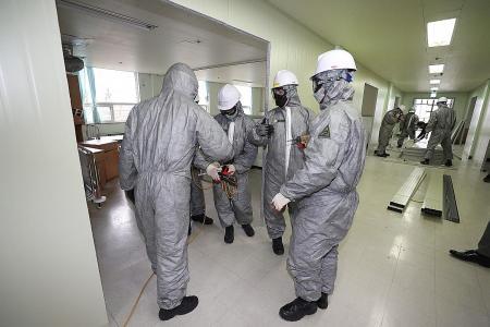 Many wait for hospital beds in S. Korea as coronavirus cases surge