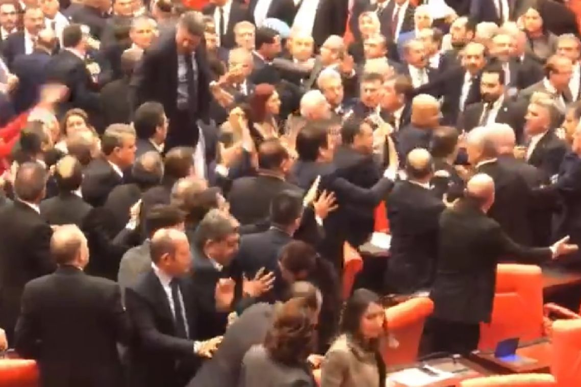 Fists fly in Turkish parliament after opposition MP criticises President Erdogan