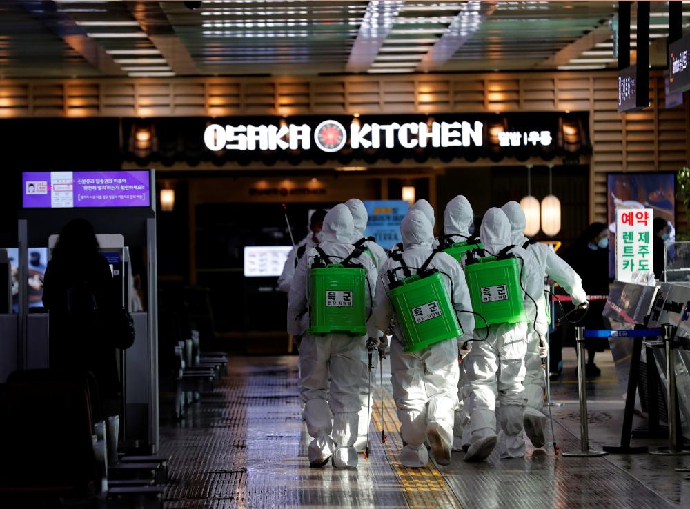 S. Korea summons Japan envoy over travel curbs in Covid-19 row