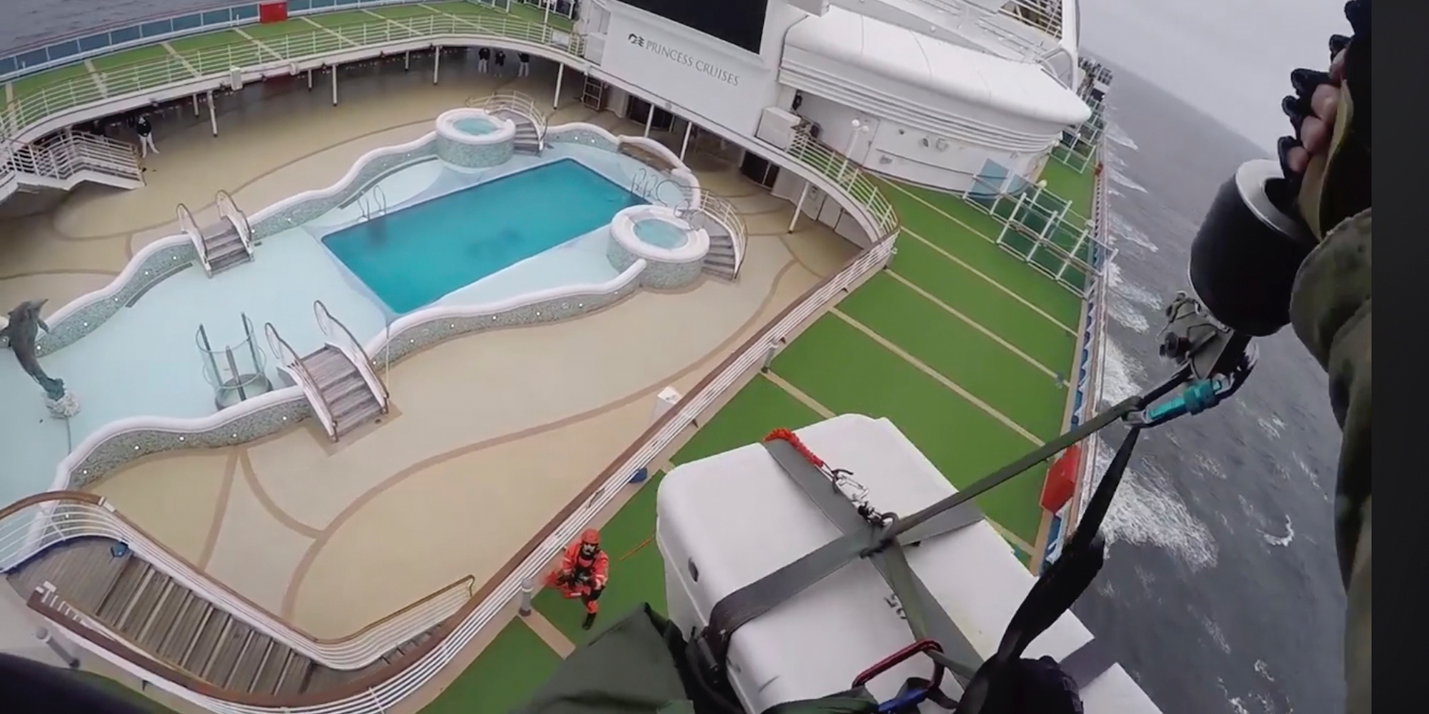Wild video shows a military helicopter dropping coronavirus test kits to the Grand Princess cruise ship