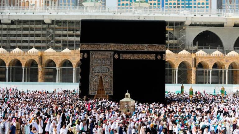 Saudi risks fallout with coronavirus curbs on holy sites