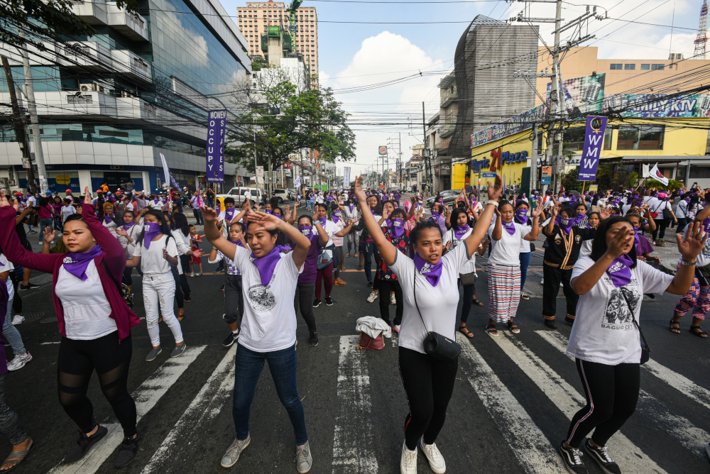Thousands rally in Asia for International Women's Day despite virus fears