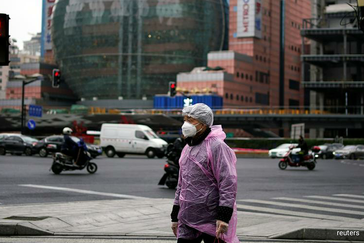 China's President Xi visits Wuhan as number of new coronavirus cases tumbles
