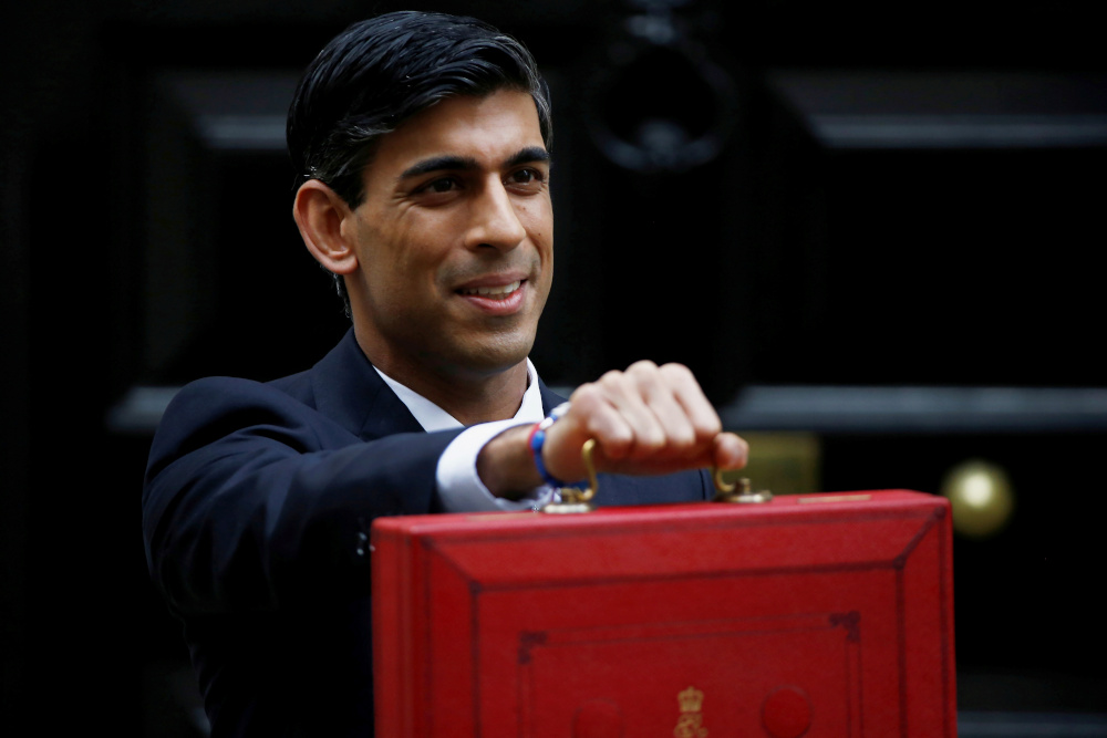 UK finance minister says travel bans will hurt economy