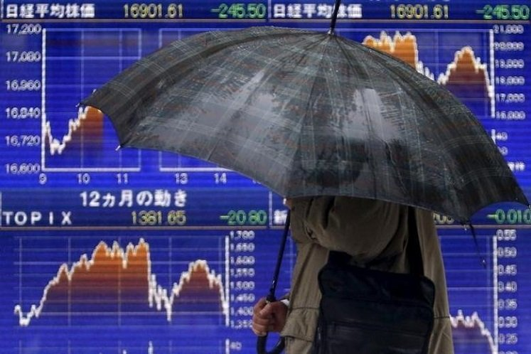 Japanese stocks dive deeper into bear market as Trump stuns with travel ban
