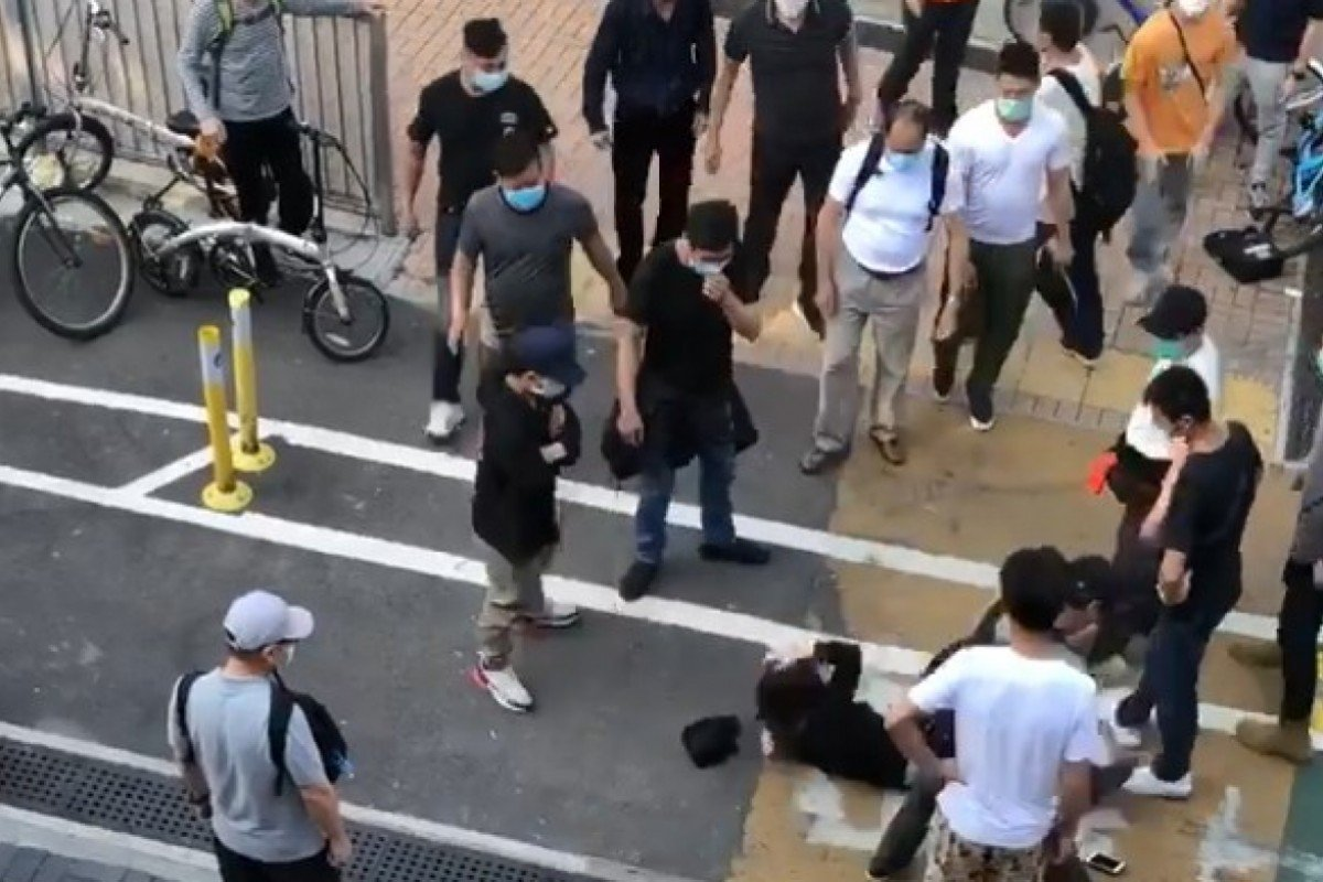 Three men arrested over attack on Hong Kong activists who tried to intervene in fracas on street