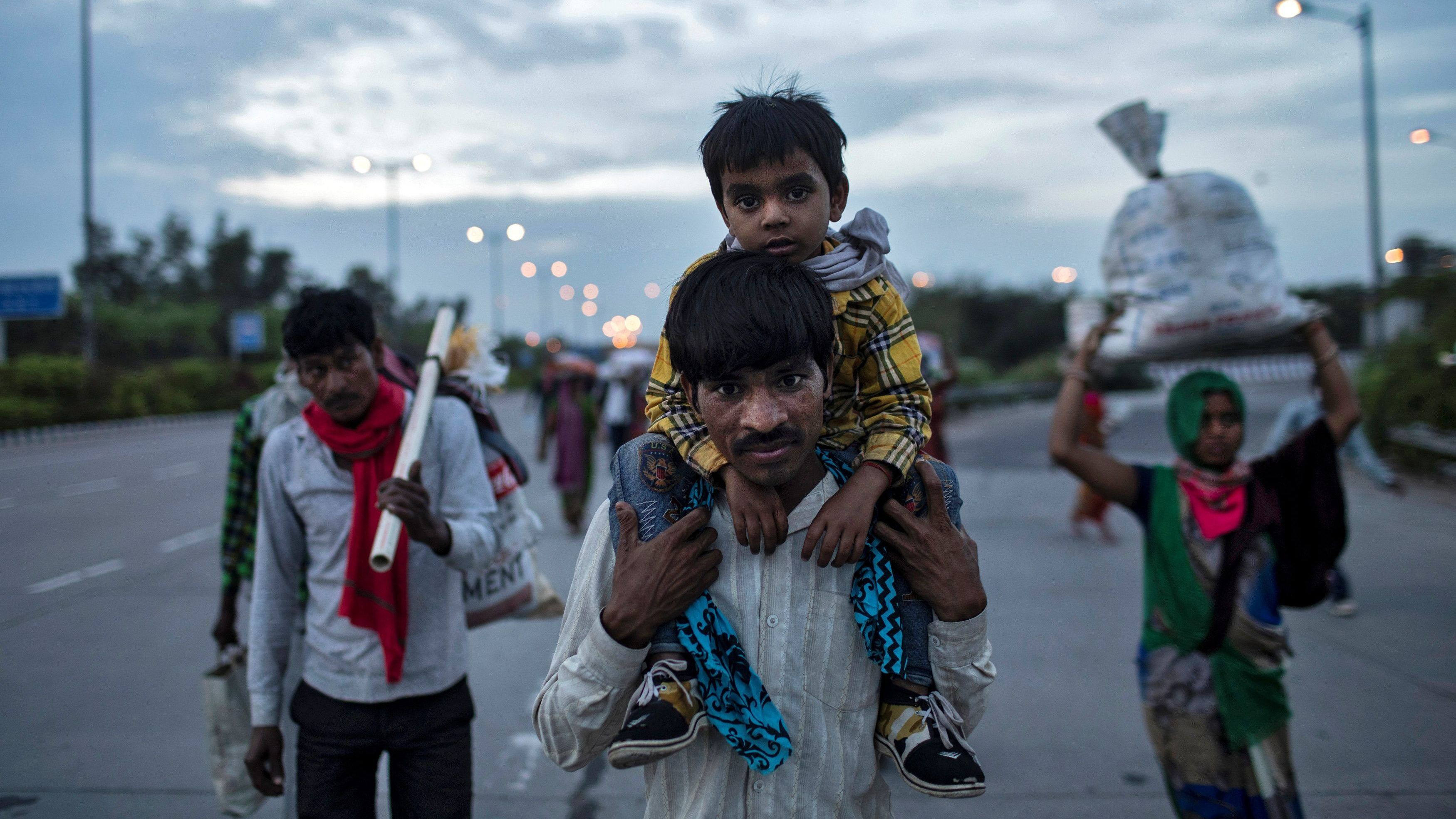 Photos: In locked down India, poor migrants are on a long march back home