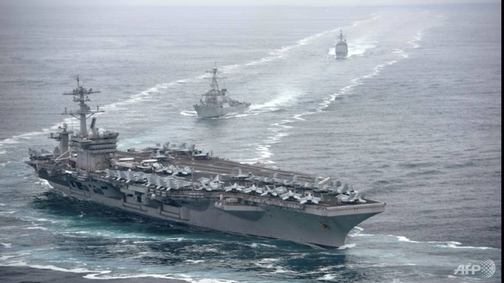 Virus cases spike on US aircraft carrier