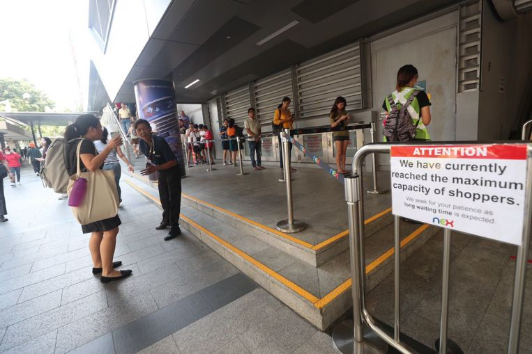 Crowd-limiting measures at malls, public venues as new safe distancing rules kick in