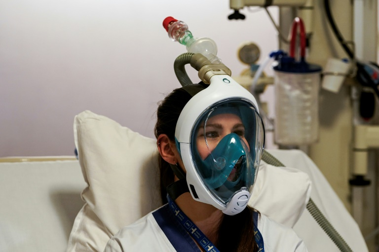 Hospitals turn to snorkel masks amid respirator overload