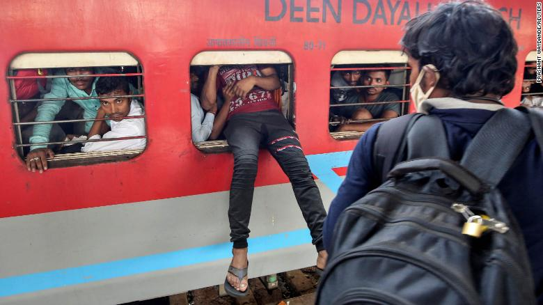 Migrant workers sprayed with disinfectant in one Indian state