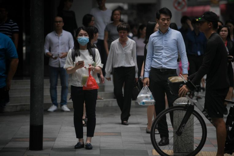 Coronavirus: Benefits of mask use by healthy people topic of debate in Singapore