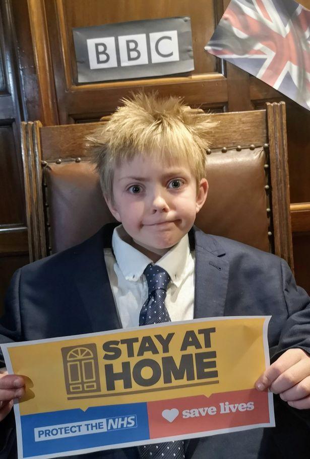 Boris Johnson 'lookalike', 9, writes virus rap as blond locks grow out in quarantine
