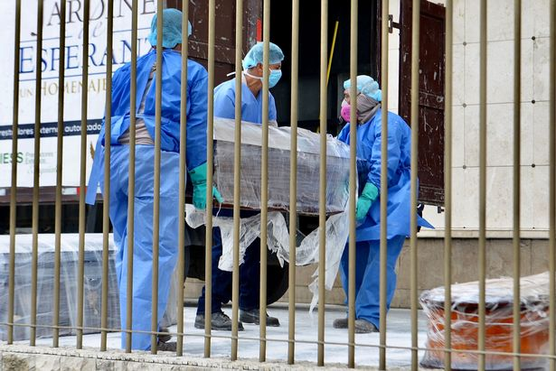 Children isolate with dad's body as city can't bury coronavirus dead fast enough