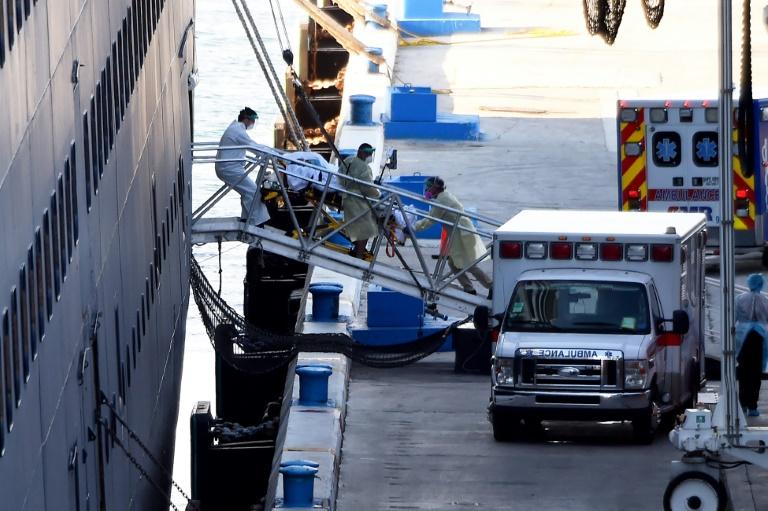 Passengers from virus-hit ships start leaving Florida