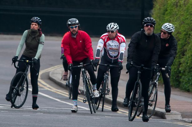Cyclists ignore UK coronavirus lockdown rules as they ride together in the sun