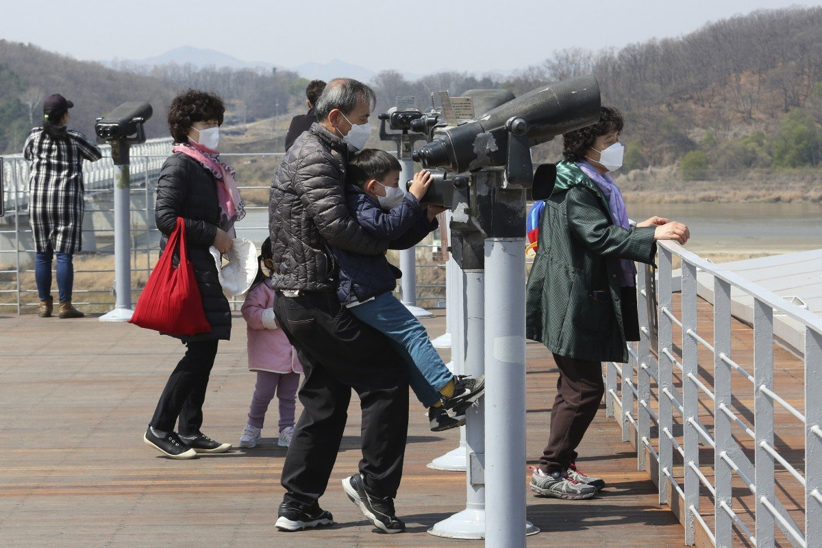 Coronavirus: South Korea urges caution as scenic spots packed amid dwindling case numbers