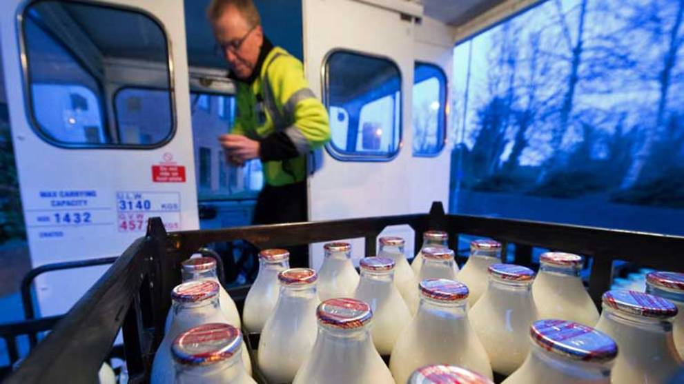 Deprived of customers, British farmers throw away milk