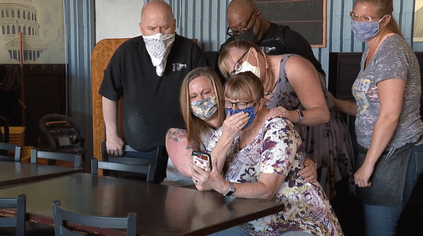 Anguished daughters weep while watching coronavirus victim mother's funeral on FaceTime