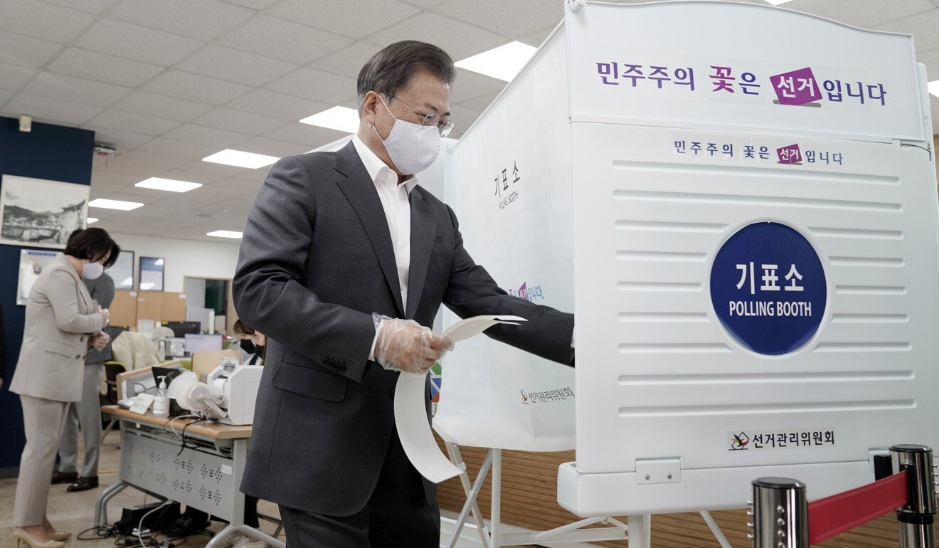 South Korea election: victory for Moon Jae-in's party as voters turn out in record numbers despite virus